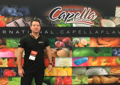Ryan Silva with Capella Flavors backdrop